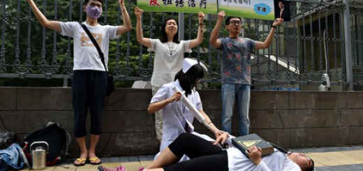 Protesters outside a Beijing court which is hearing a case against gay-straight 'conversion therapy'